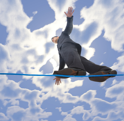 Mp900438797_man_focusing_on_a_balance_beam